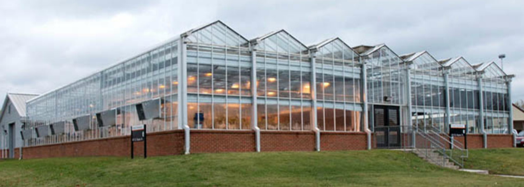 The sprawling glass and brick North Greehouse of the UTIA facility