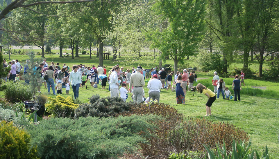 A large group of people gather for the Eggstravaganza, an Easter egg hunt event at UT Gardens