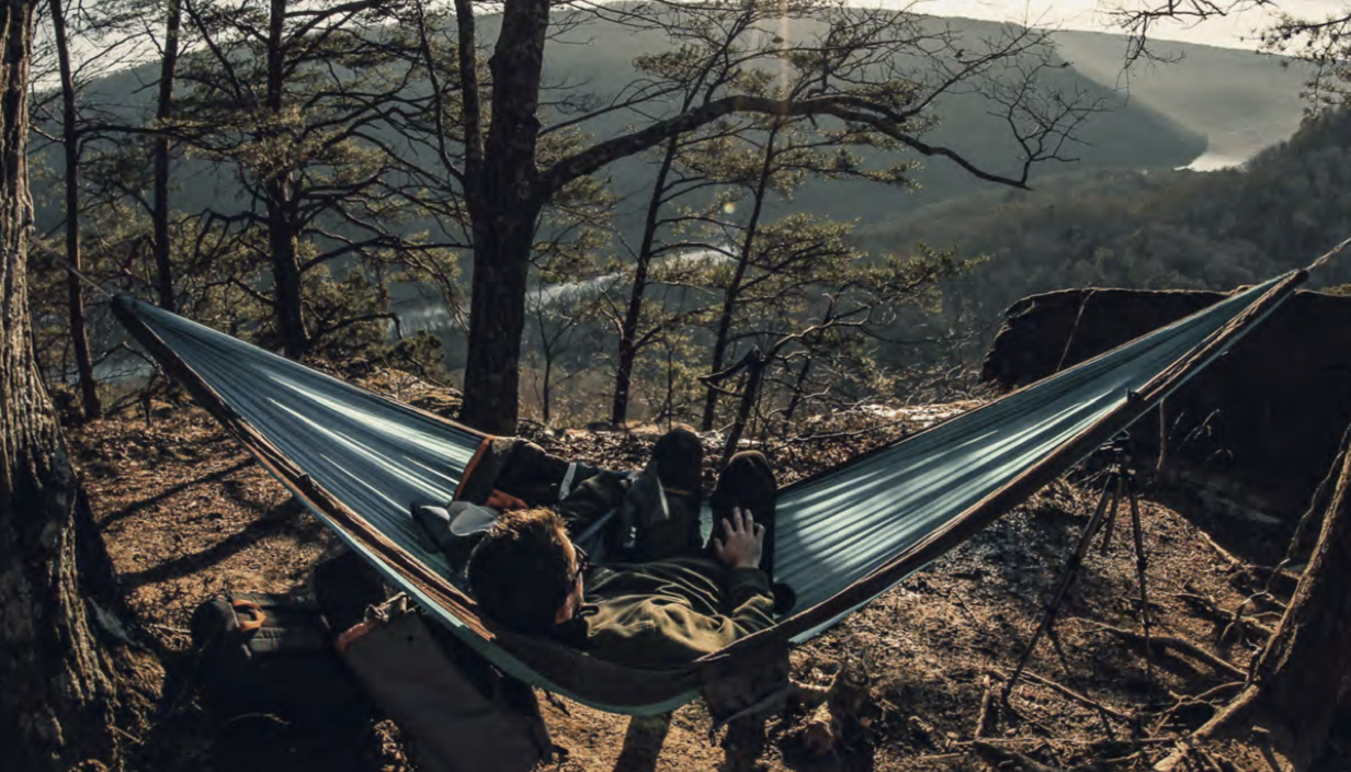 A student lounges in a hammock in the Tennessee mountains