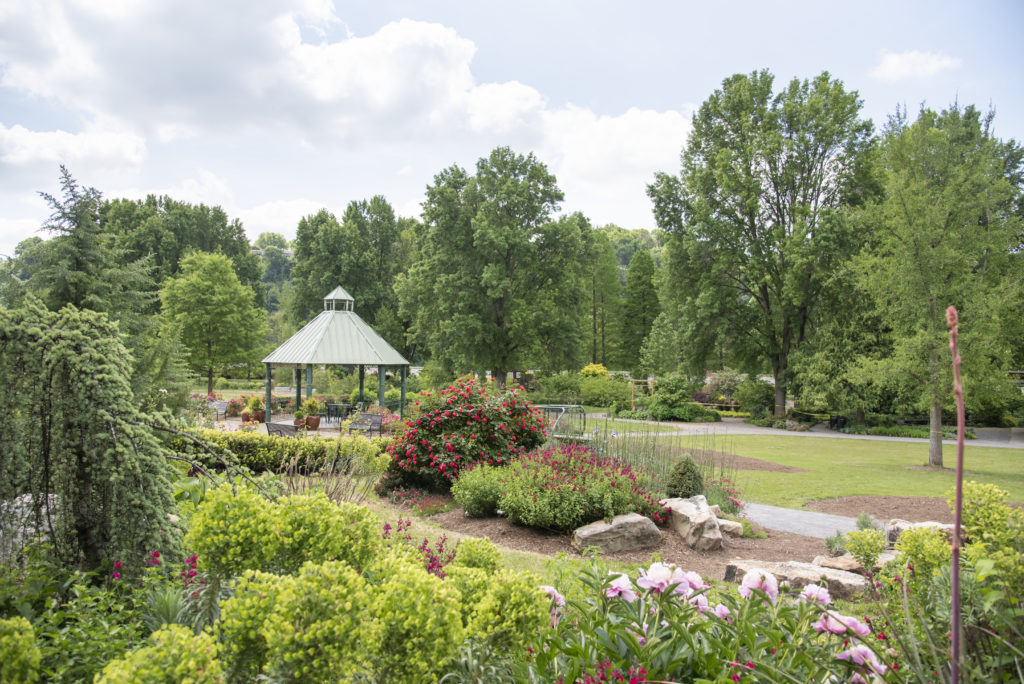 A view of a gazebo amongst UT Gardens in bloom on a clear Spring day
