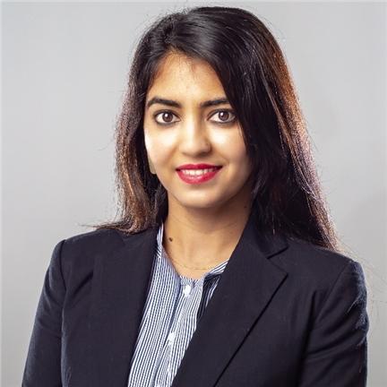 Headshot of Reena Sharma