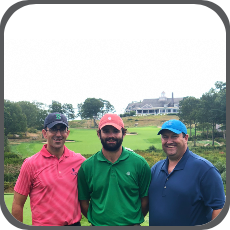 Professor Jim Brosnan and Associate Professor Brandon Horvath stand with a turfgrass science and management alumnus at the golf course at which he works
