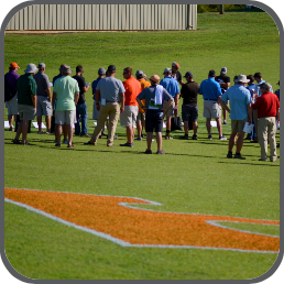 Many attendees gather on the research fields on the East Tennessee Research and Education Center with a Power T painted on the turfgrass