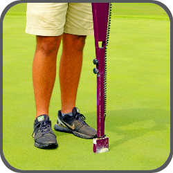 a close up of a metal device sticking into turf to test soil moisture